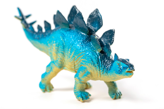 Stegosaurus dinosaur toy on white background