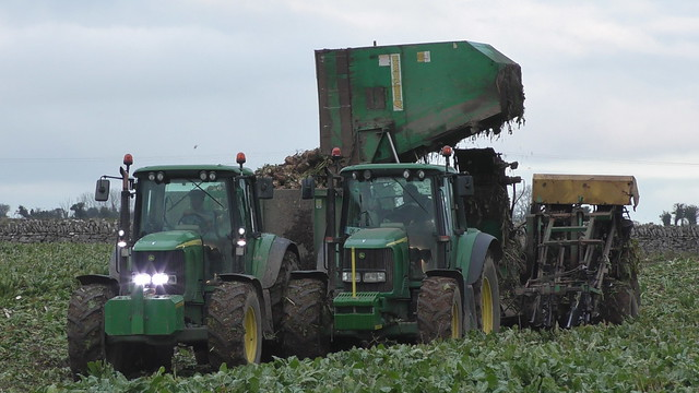 John Deere 6920 Tractor with an Armer Salmon Beever Twin Row Beet Harvester unloading to a Smyth Trailer drawn by a John Deere 6920 Tractor