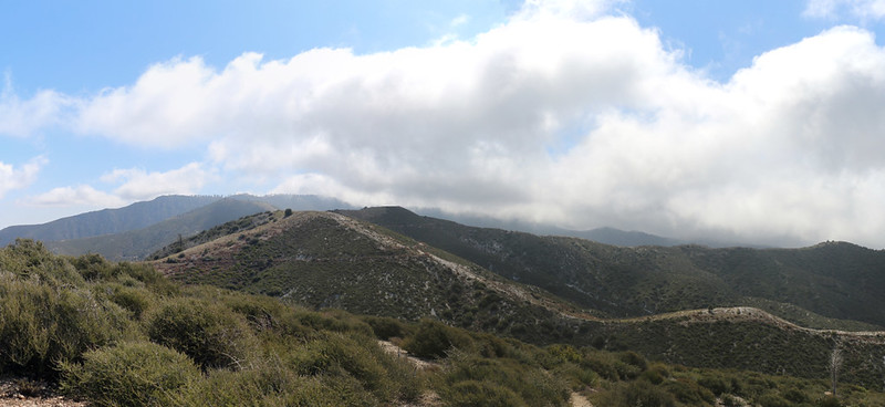 Panorama view south and east with the thick marine layer clouds pouring over the ridgetops