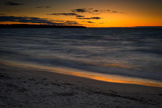 Long exposure of waves at sunset at Wildernes State Park, Lake Michigan