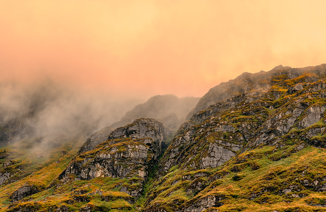 Misty mountains next to Loch Restil, Scotland.