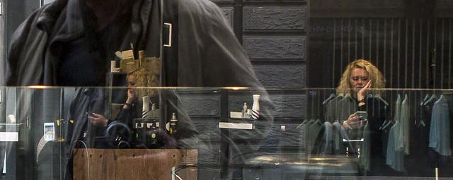 sneak street shot of bored hairdresser during covid