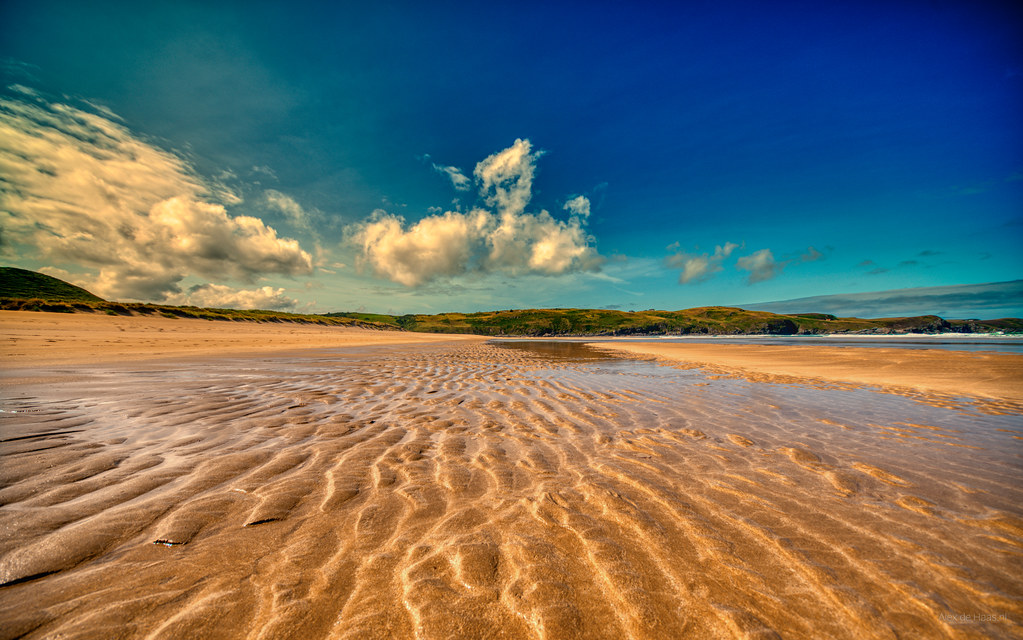 Puffy clouds playing on Strathy Beach, Scotland.