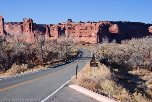 Sign marking Courthouse Wash with views back toward Park Avenue, Arches National Park, Utah