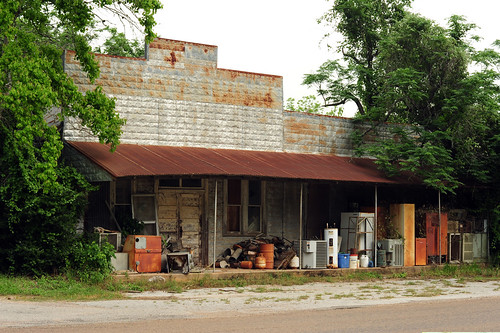 usa texas coloradocounty rockisland abandonedbusiness storefront architecture vernacular rust decay abandoned pressedstampedmetalsiding texasghosttown us90a junk