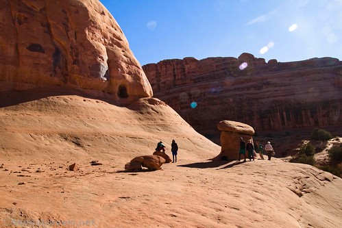 The Tunnel is more visible in this photo from beyond the hoodoo - the slickrock is deceptively steep.  Arches National Park, Utah