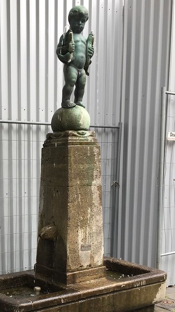 Statue in Aachen located to the side of a street near the Aachener D.o.m. , cropped Photograph , Martin's photograph , Aachen , Germany , June 9. 2019