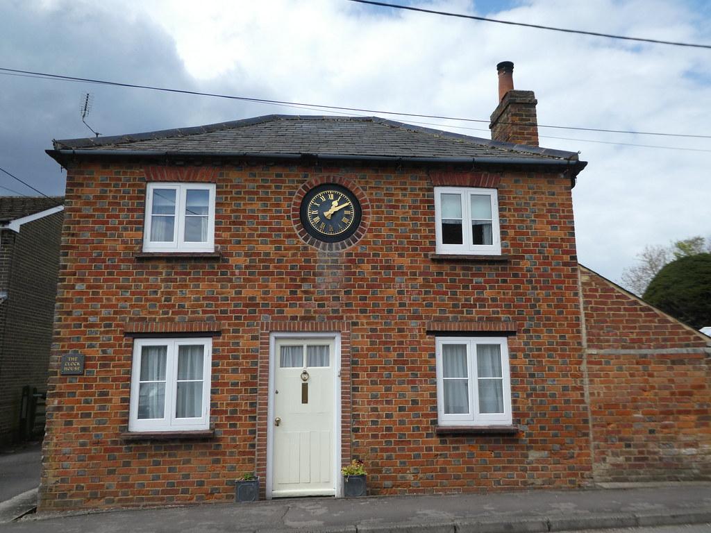 House with clock over the door, Woolhampton, West Berkshire