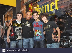 christian-audigier-presents-with-the-jonas-brothers-smet-his-latest-fashion-collection-honoring-french-rock-legend-johnny-hallyday-in-his-store-of-melrose-avenue-in-los-angeles-ca-usa-on-july-29-2006