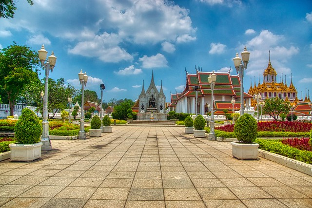 Statue of King Rama III and Wat Ratchanatdaram Worawihan with Loha Prasat on Rattanakosin island (Old Town) in Bangkok, Thailand
