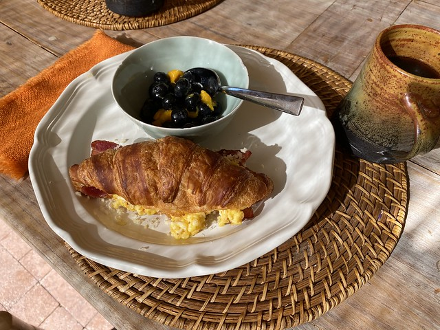 Bacon and egg croissant-wich with fruit