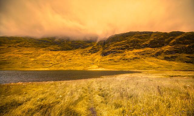 Misty mountains at Loch Restil, Scotland.