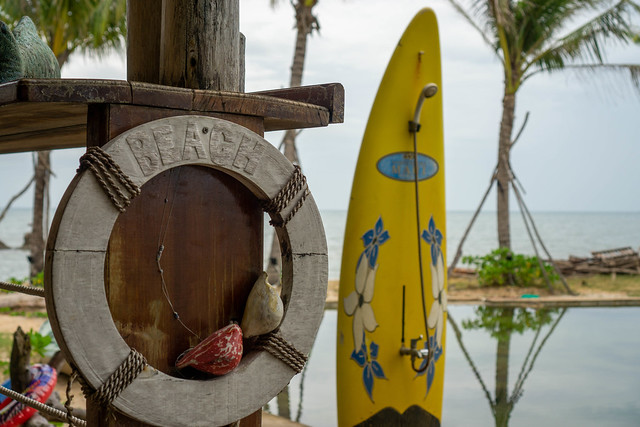 Wooden Lifebuoy next to a Shower attached to a Surfing Board at a Natural Swimming Pool at Rory's Beach Club on Phu Quoc Island, Vietnam