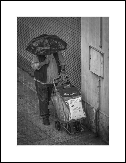 A mailman in the rain