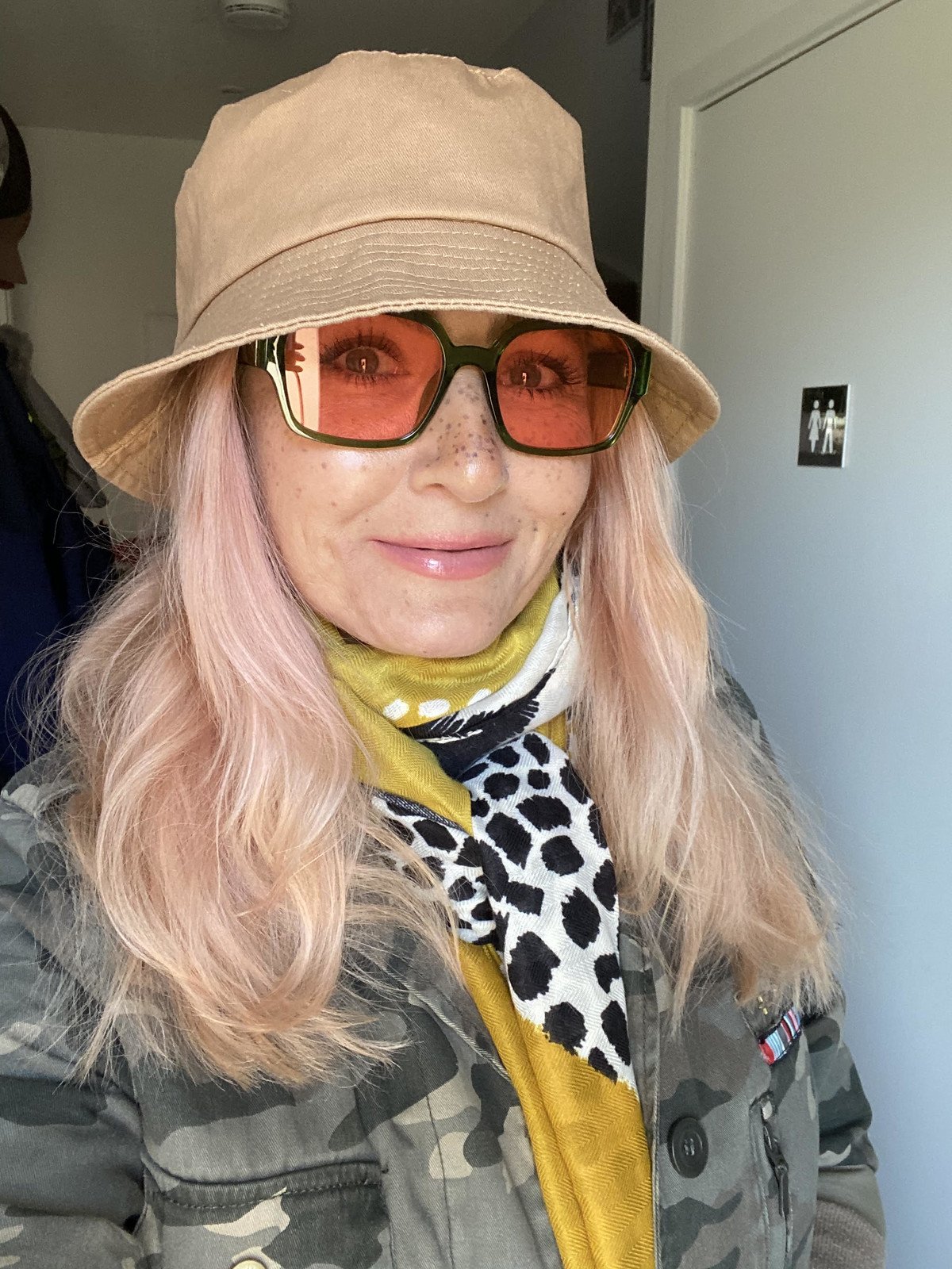 Mental Health Update: I'm Actually Doing Okay (Honestly) / over 40 blogger Not Dressed As lamb AKA Catherine Summers wearing a camel bucket hat, square sunglasses with orange lenses, camo jacket and patterned scarf