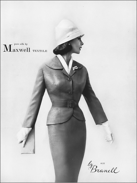 Model in silk suit by Branell, Vogue, February 1, 1957