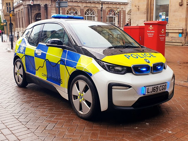 LJ69 CGO, a Cumbria Constabulary, BMW i3 electric car, on blues in Carlisle City Centre.