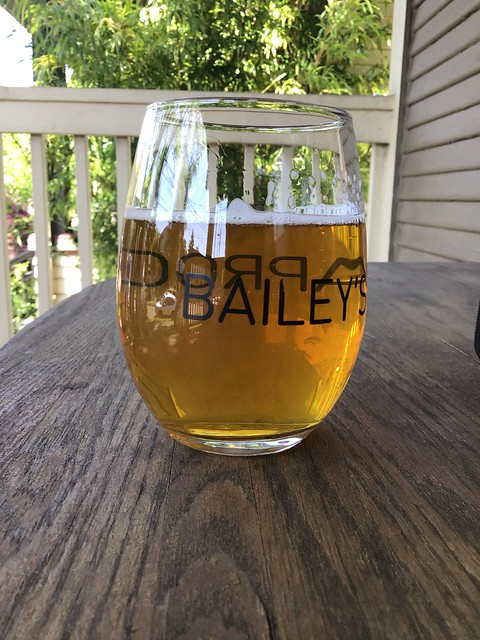 Pfriem's Mosaic pale ale, in glass on table outside
