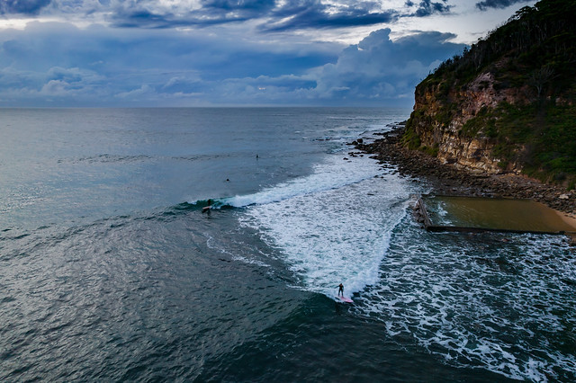 Cloudy aerial seascape and headland