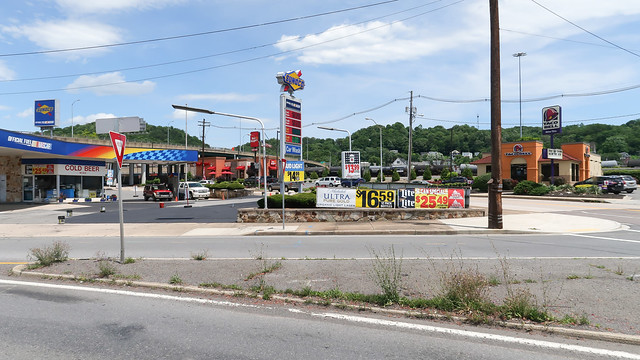 Sunoco-Taco Bell townscape with traffic island of chicory weed.