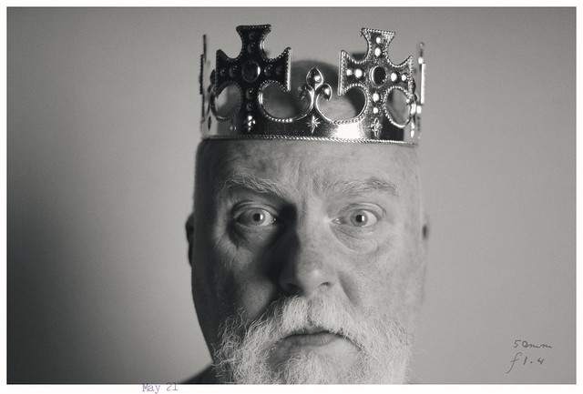Portrait of a Man wearing a Plastic Crown taken with a Pre-AI Nikkor 50mm f/1.4 lens