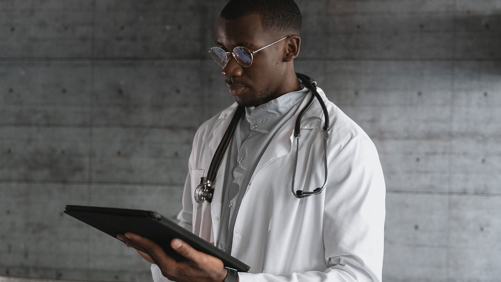 A doctor looking at a clipboard