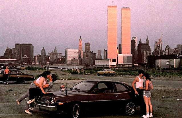 Hey, It's Saturday evening. Time to suck down a few brews with your girlfriend and make-out on a Ford Pinto. The glow of the setting sun reflects off the World Trade Center and Manhattan across the Hudson. Exchange Place. Jersey City. July 1983.