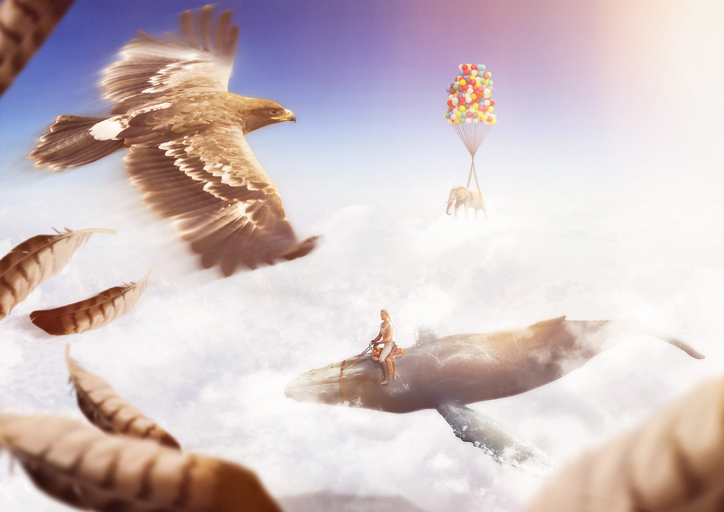 Photo compositing of multiple animals (eagle, whale, elephant) flying in the air through the clouds.
