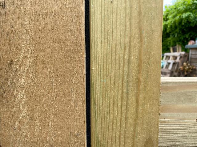 Gap closed between wall panel frame and green oak post