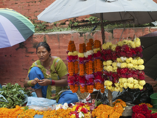 Nepali woman selling flowers