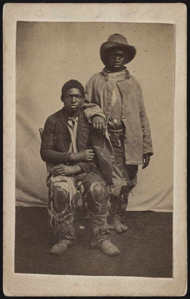 [Two unidentified escaped slaves wearing ragged clothes] (LOC)