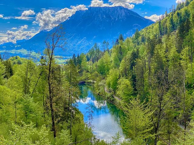 Gfaller Stausee reservoir lake on the Reschmühlbach creek with Zahmer Kaiser mountain range in the back in Bavaria, Germany