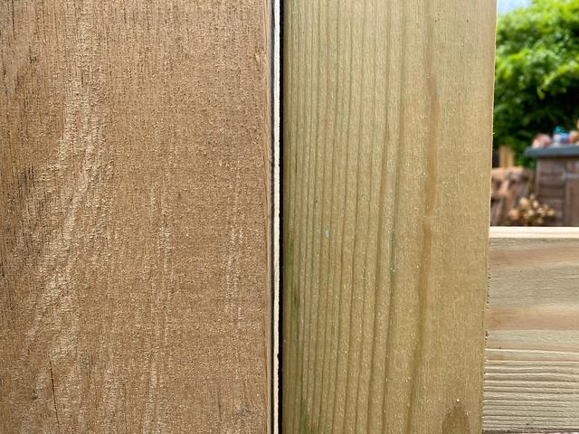 Initial gap between wall panel frame and green oak post