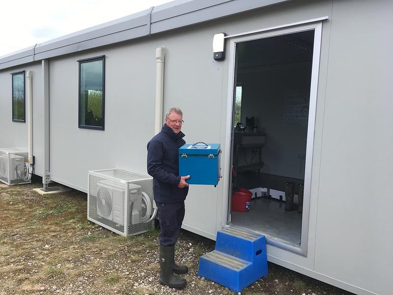 Tony Durkin carrying a portable incubator, April 2021.