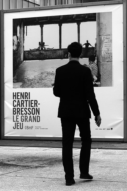 In front of the exhibition poster