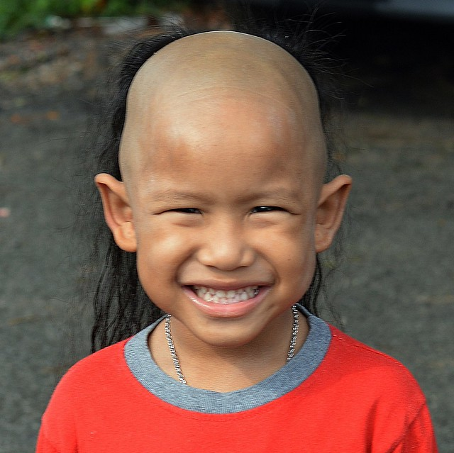 boy with big smile  and unusual hair style