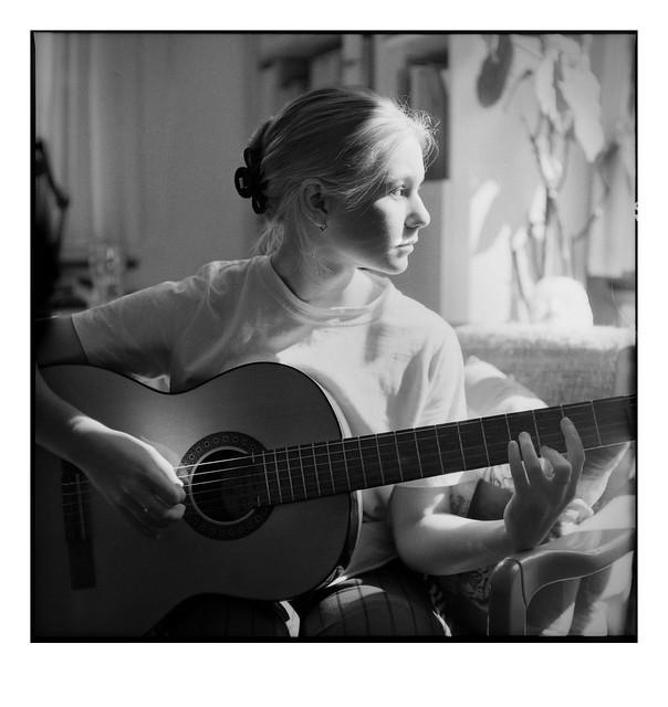 strumming her own tune