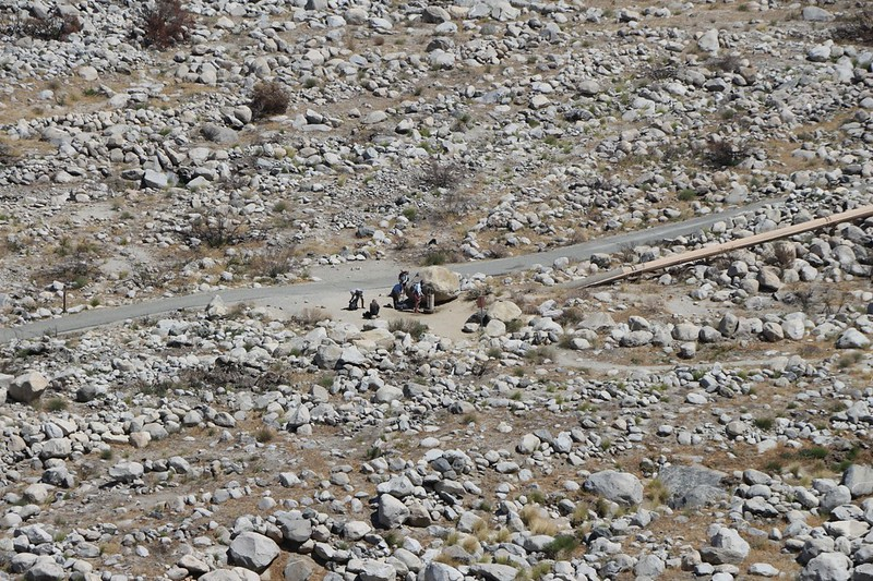 Zoomed-in view of PCT Thru-Hikers collecting water at the Snow Creek water faucet - I would be there soon