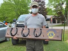 Chris Gilbert presenting a coat rack in appreciation.
