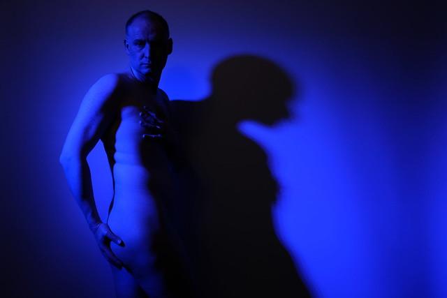 Jonathan  a nude man in blue light
