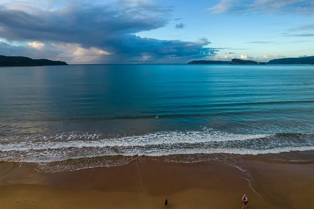 Rain Clouds and Sunrise at the Beach