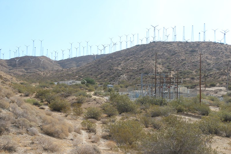 Mesa Wind Farm maintenance building up ahead where hikers can often get water and air conditioning on hot days