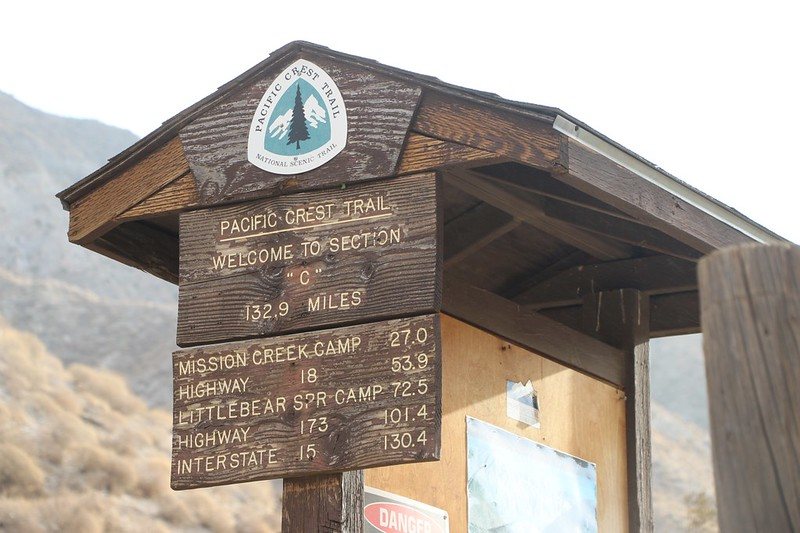 Kiosk stating Welcome to Section C on the Pacific Crest Trail with mileages to places on the way to I-15