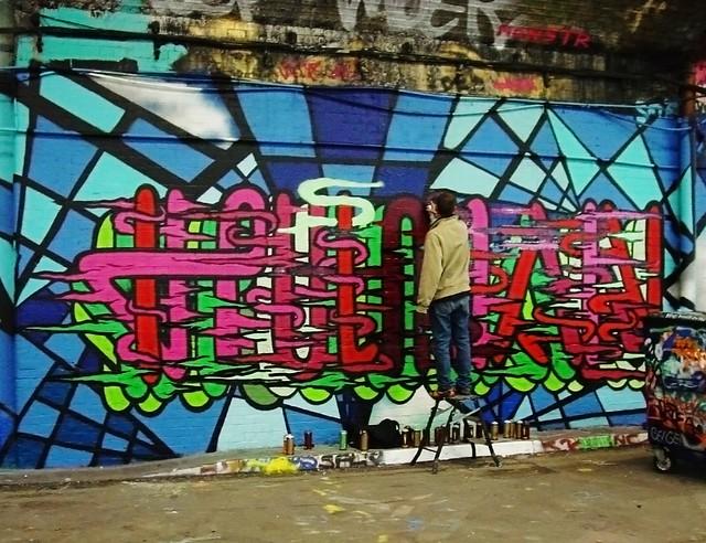 """Jano writing """"Human"""", Leake St London 2009"""