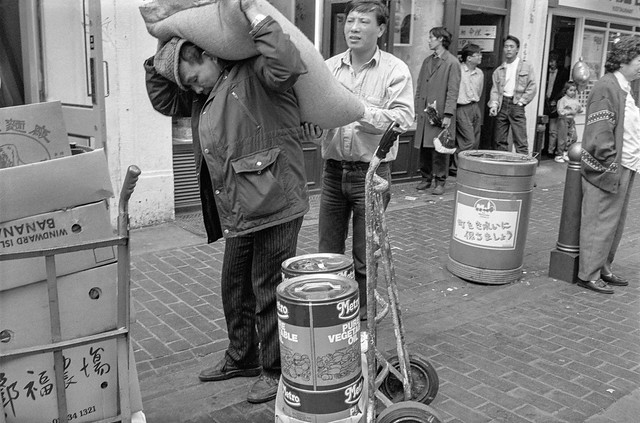 Man with sack, Gerrard St, Soho, Westminster, 1990, 90-62-45