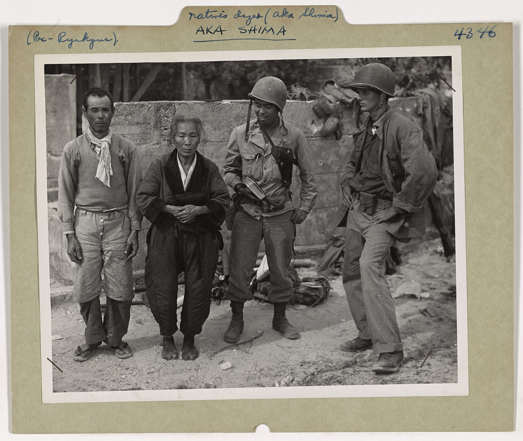 American soldiers, landed by Coast Guardsmen on Aka Shima in the Keramas, find the civilians stunned by the mighty strike to the very doorstep of Japan.