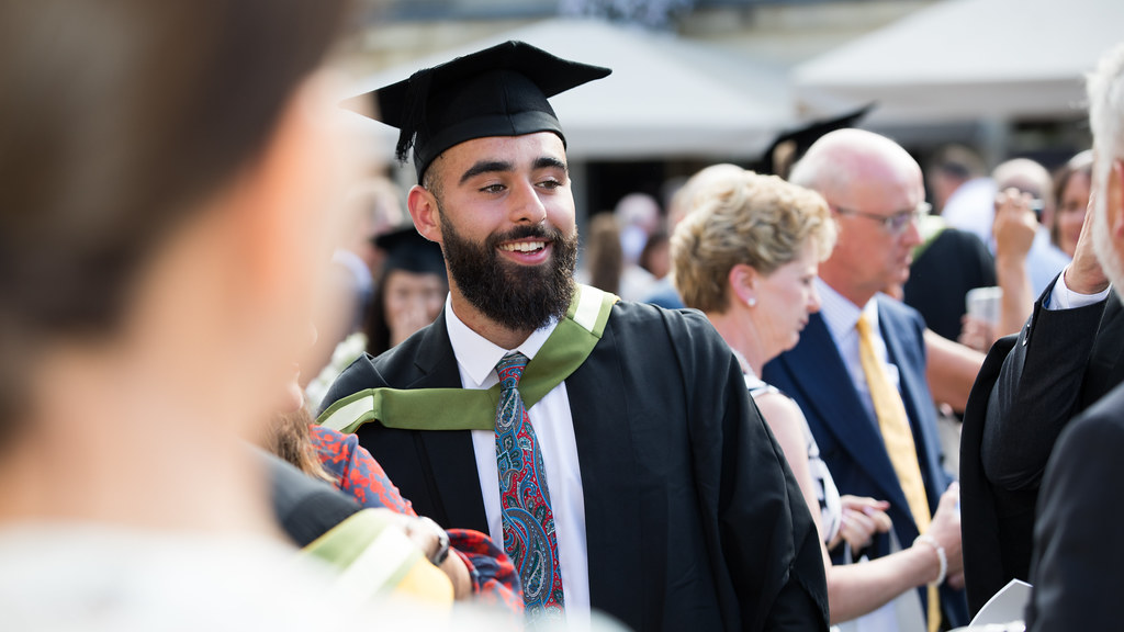 A student in graduation gown and cap