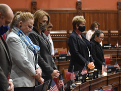 State Rep. Kathleen McCarty and her colleagues pause for a moment of silence in memory of her friend on the House floor on May 24th.
