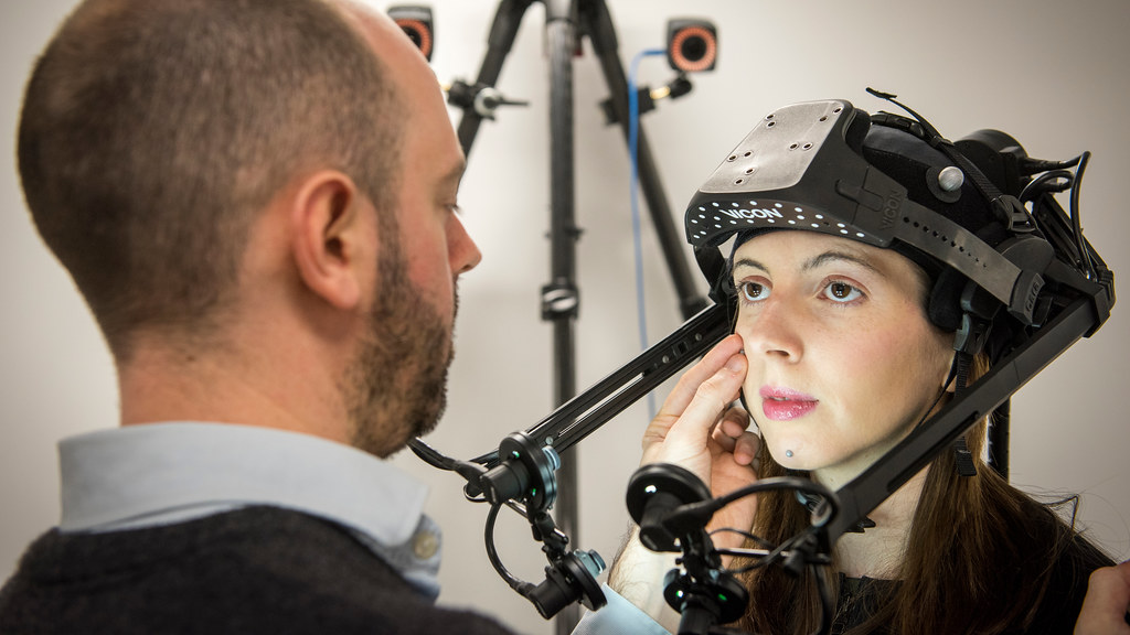 A researcher and volunteer using motion capture equipment