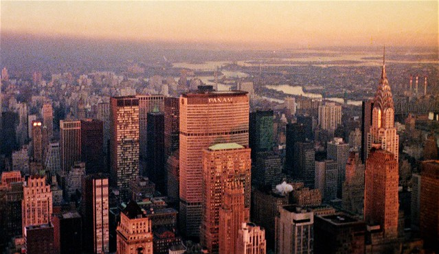 The golden setting sun illuminates the PAN AM, Chanin and Chrysler Buildings on what was then a typically smoggy sunset.  Looking northeast to the East River from the top of of the Empire State Building. New York. Jan 21, 1973